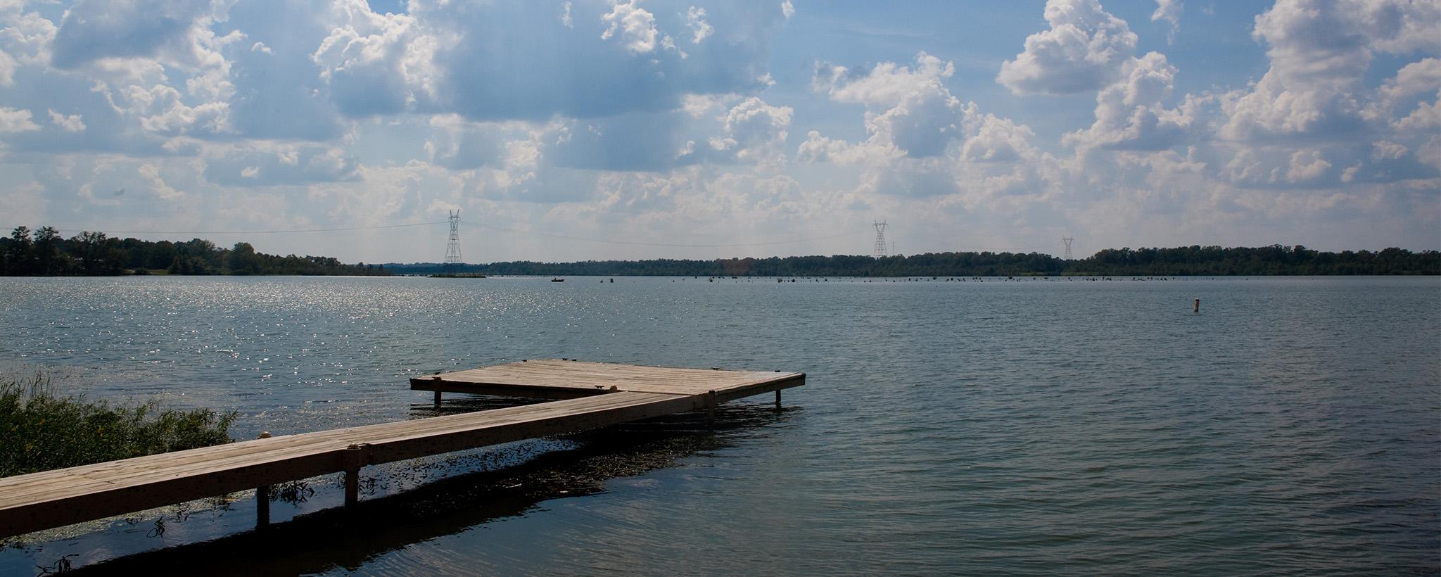 Dock under puffy clouds
