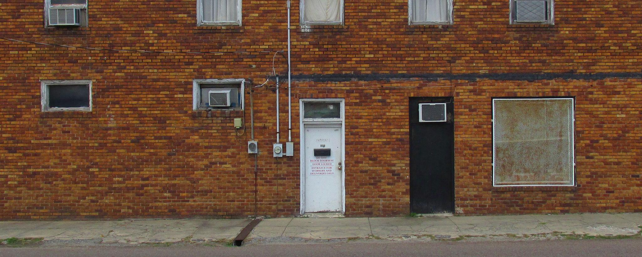 Doors on a Brick Wall