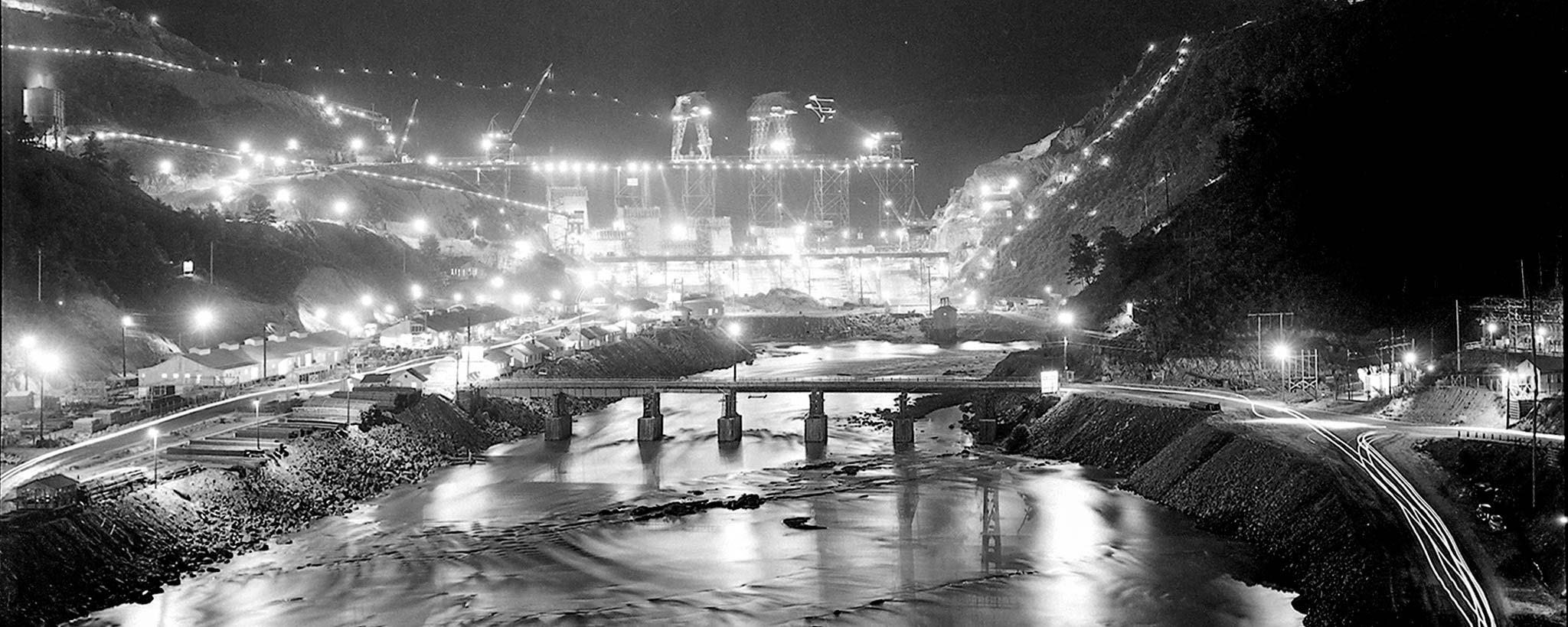 dam construction at night