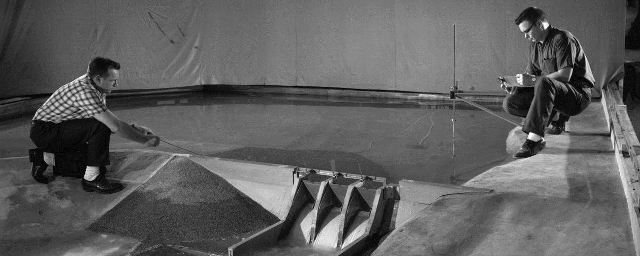 engineers and model of dam