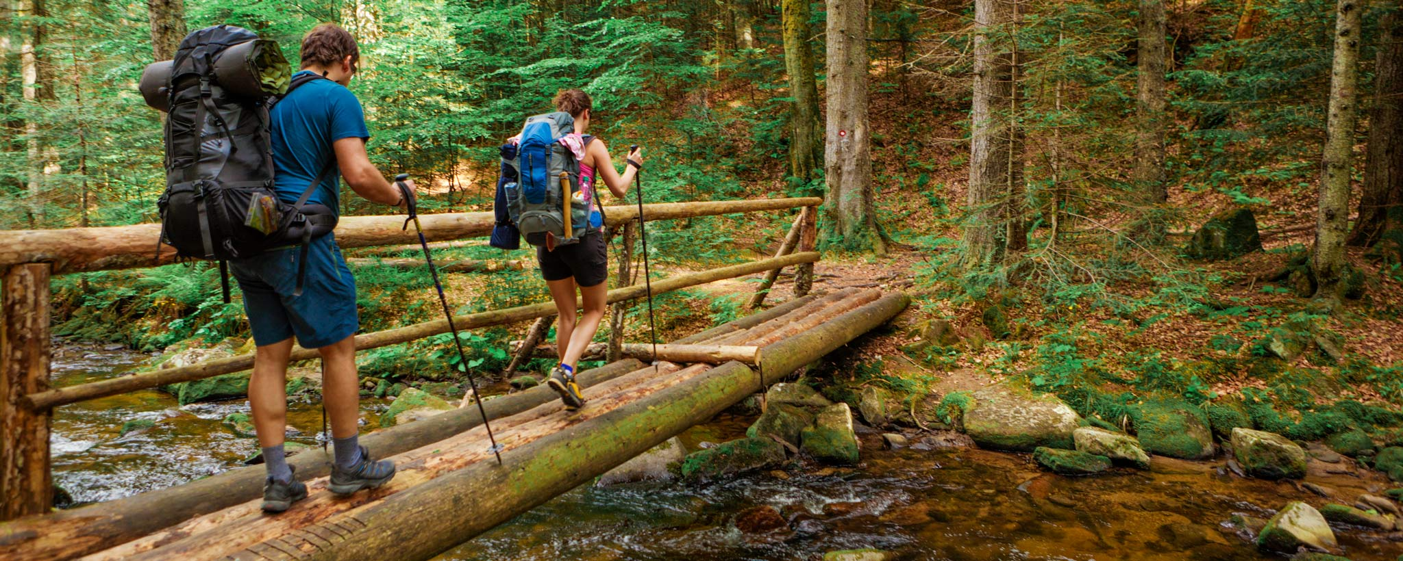 hikers  crossing footbridge