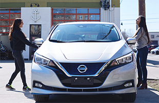 Women getting into Nissan electric vehicle