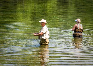 man fishing in river