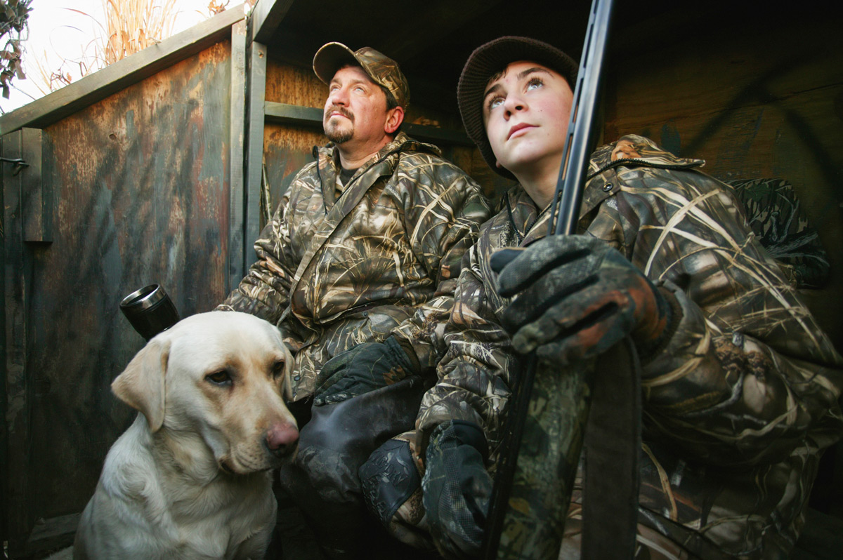 Hunting Dad, Son and Dog