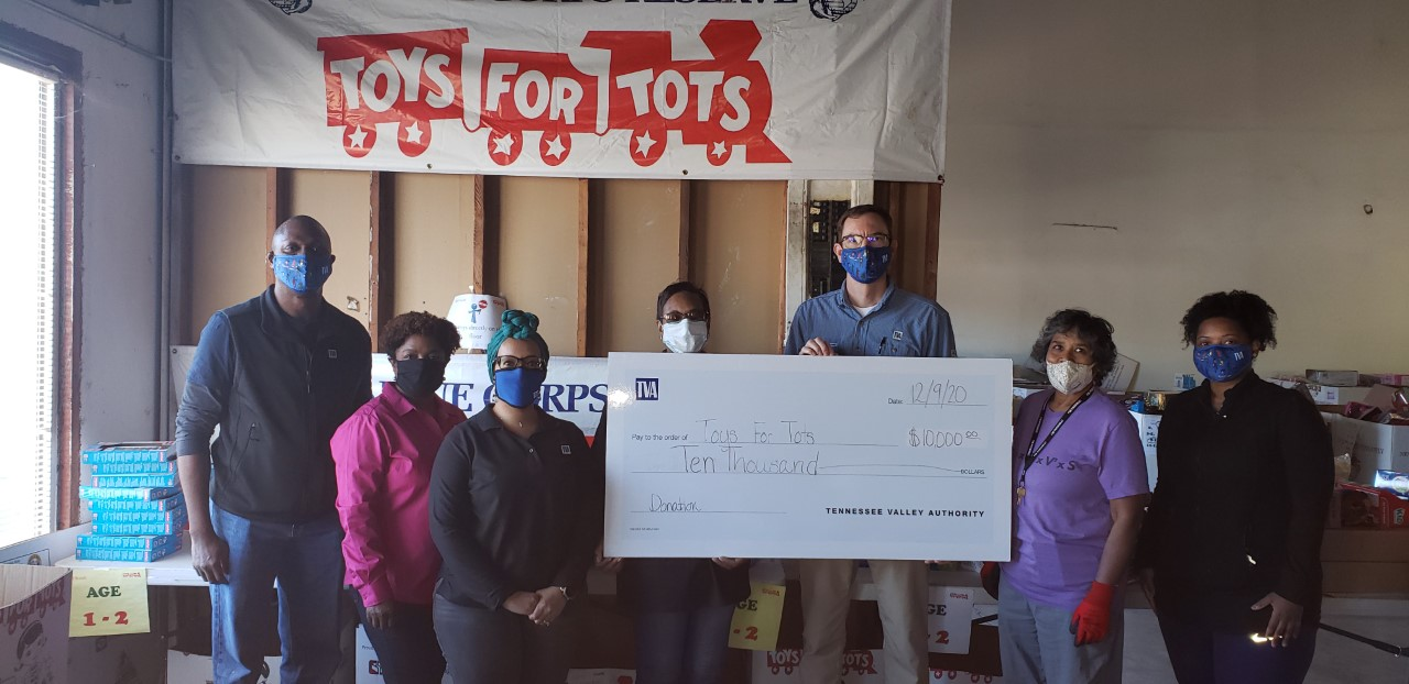 memphis employees check presentation for Toys for Tots