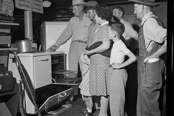 people looking at electric appliances