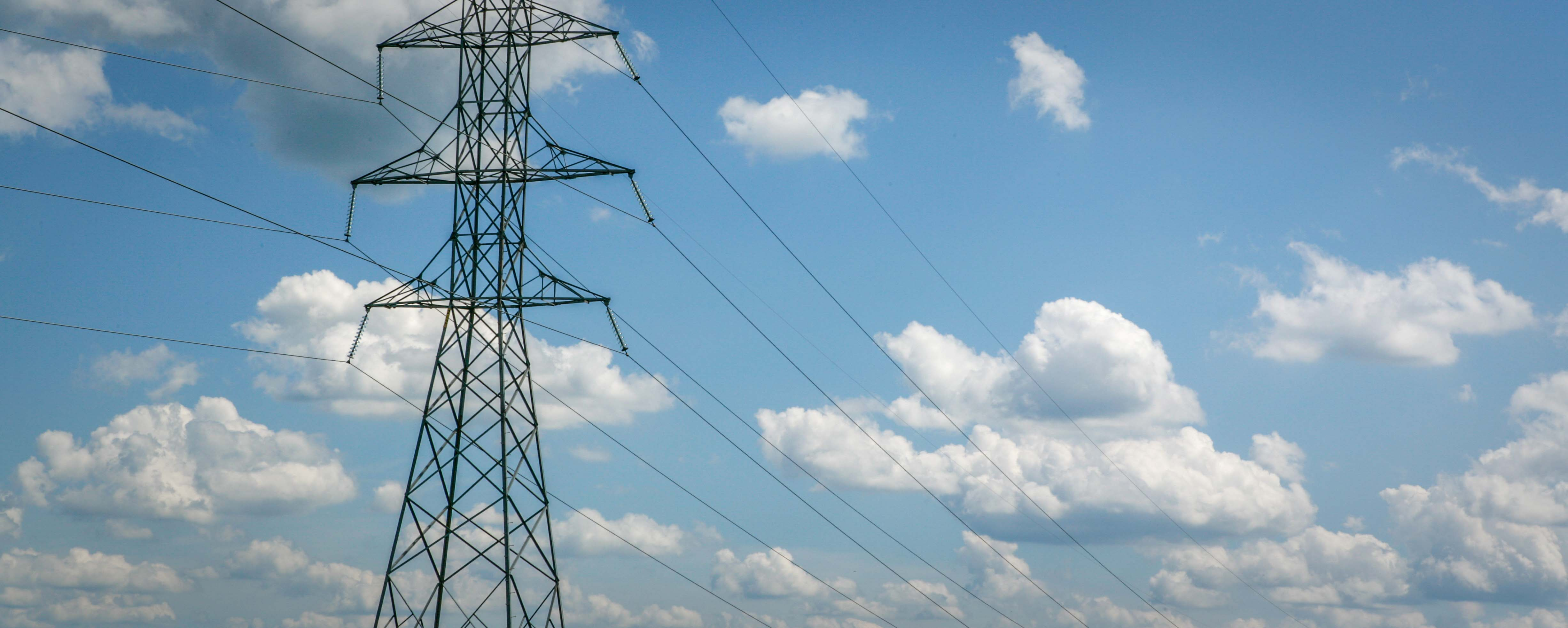 transmission tower with clouds