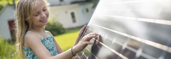 girl at solar panel